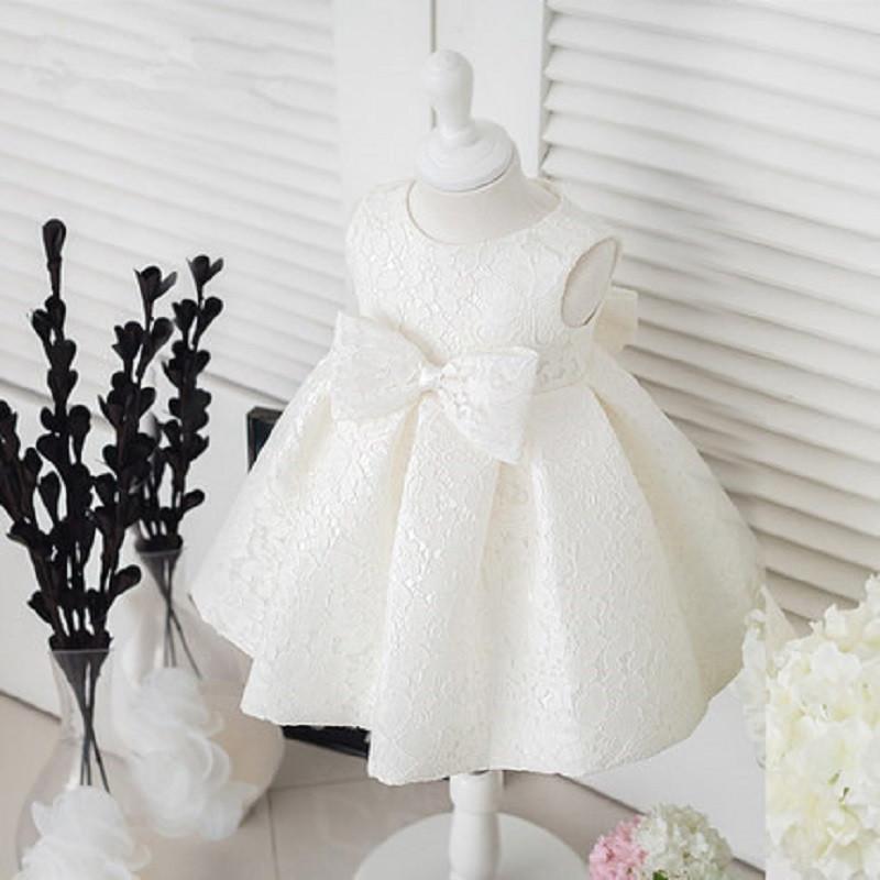 ชุดราตรีเด็กหญิง ลูกไม้ขาวแขนกุด มีโบว์ด้านหน้าและหลัง Size 90-120