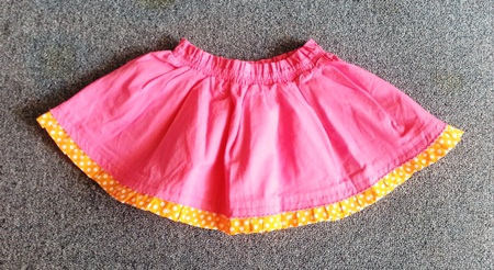 GSK-047 (18M) กระโปรงผ้าทอ Maggie & Zoe สีชมพู ระบายชายด้วยผ้าสีส้มจุดขาว มีผ้าซับใน