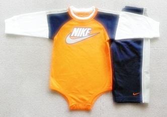ฺBS-238 (12M) ชุด Nike บอดี้สูทสีส้มอิฐ ตัดต่อสีกรมท่า-เทา-ขาว กุ้นริมขาว พร้อมกางเกงตัดต่อสีเทา