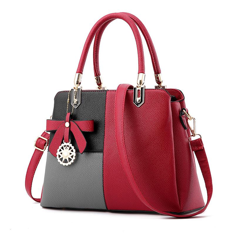 Pre-order ขายส่งกระเป๋าผู้หญิงถือและสะพายข้าง เย็บสลับสีแต่งโบว์แฟชั่นสไตล์ยุโรป รหัส Yi-8165 สีแดงสลับ
