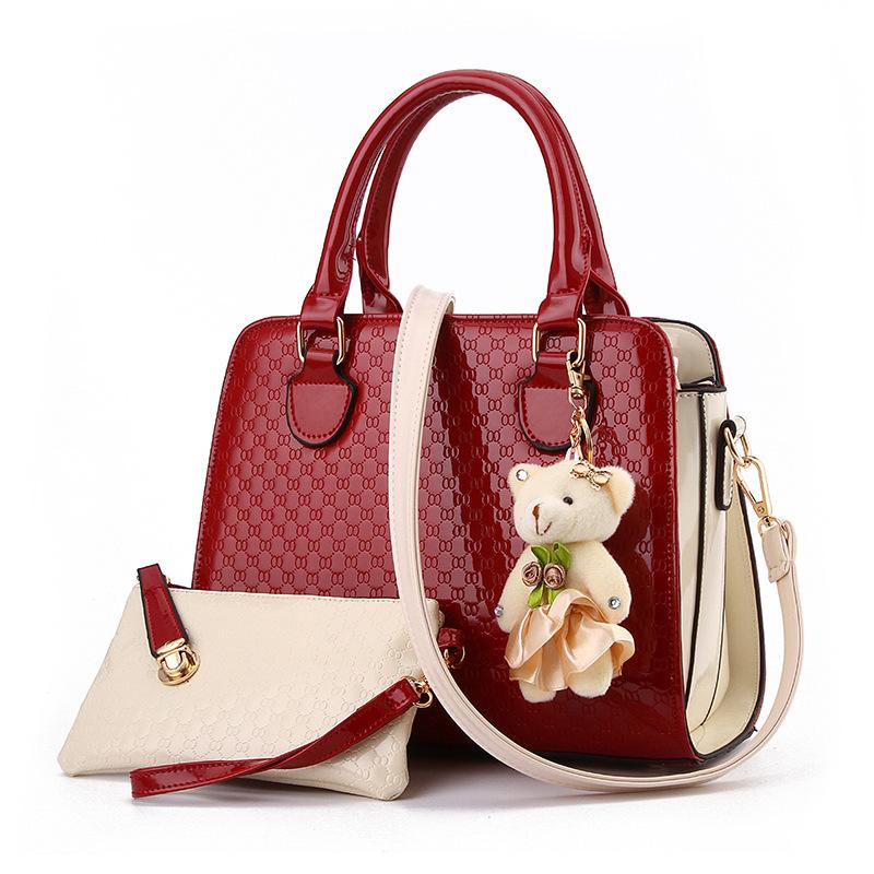 Pre-order ขายส่งกระเป๋าผู้หญิงถือและสะพายข้าง เช็ต 2 ใบหนังPUลาย OOแฟชั่นสไตล์ยุโรป รหัส Yi-8742 สีไวน์แดง *แถมตุ๊กตาหมี